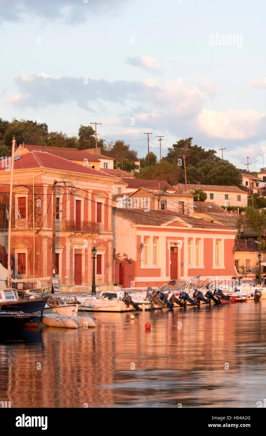 Old buildings on the waterfront at sunrise in Gaios harbour on Paxos, The Ionian Islands, The Greek Islands, Greece, - Stock Image