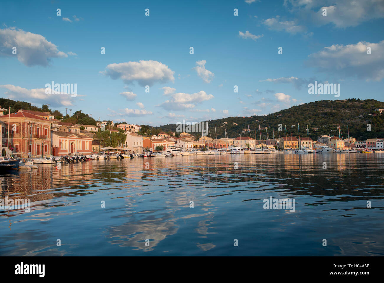 The picturesque harbour of Gaios at sunrise on Paxos, The Ionian Islands, The Greek Islands, Greece, Europe - Stock Image