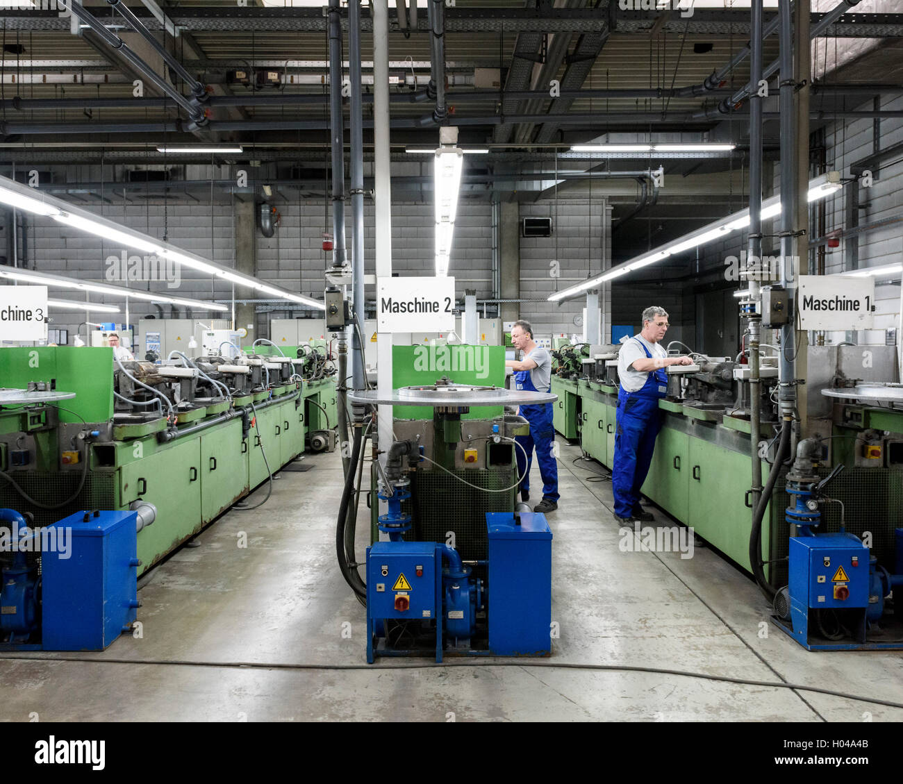 Workers check the sharpening process. Harry's Razor Blade Factory, Eisfeld, Germany. Architect: -, 1920. Stock Photo