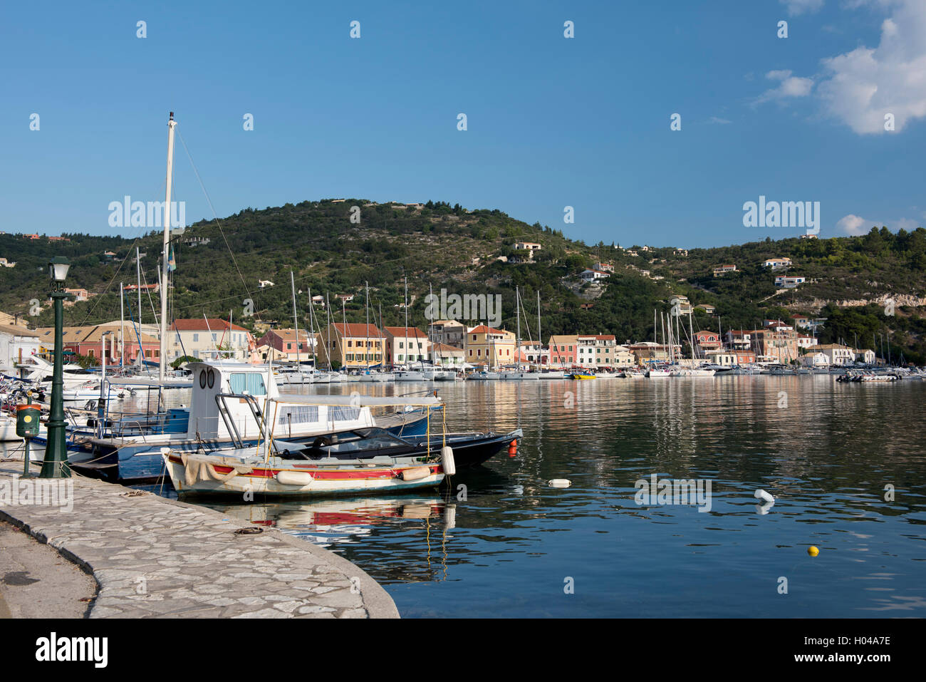 Old fishing boats and modern yachts in Gaios harbour on Paxos, The Ionian Islands, The Greek Islands, Greece, Europe - Stock Image