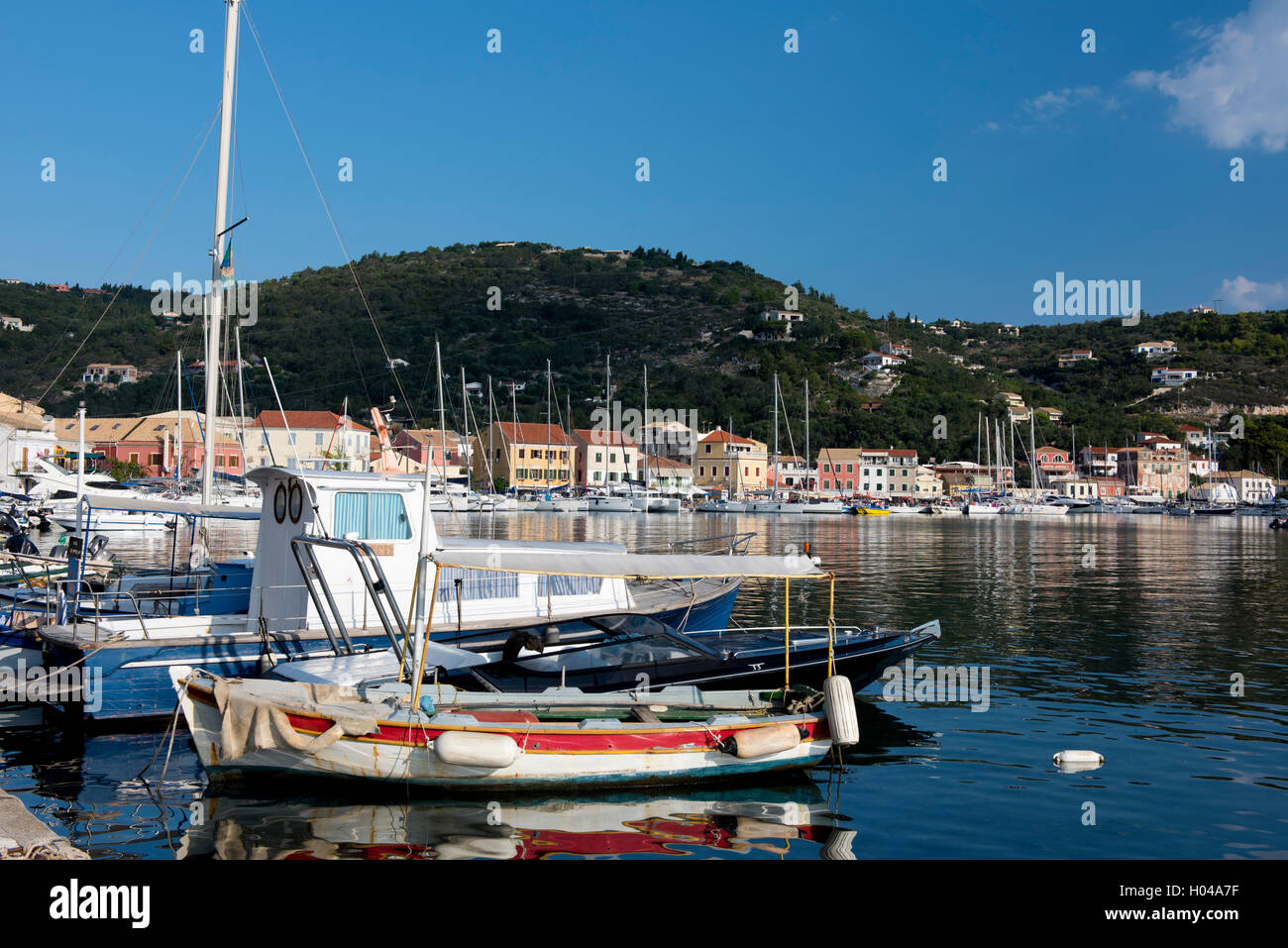 Old fishing boats and modern yachts in the Gaios harbour on Paxos, The Ionian Islands, The Greek Islands, Greece, - Stock Image