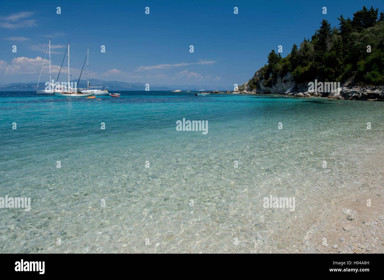 Sailing yachts off Marmari Beach on the east coast of Paxos, The Ionian Islands, The Greek Islands, Greece, Europe - Stock Image