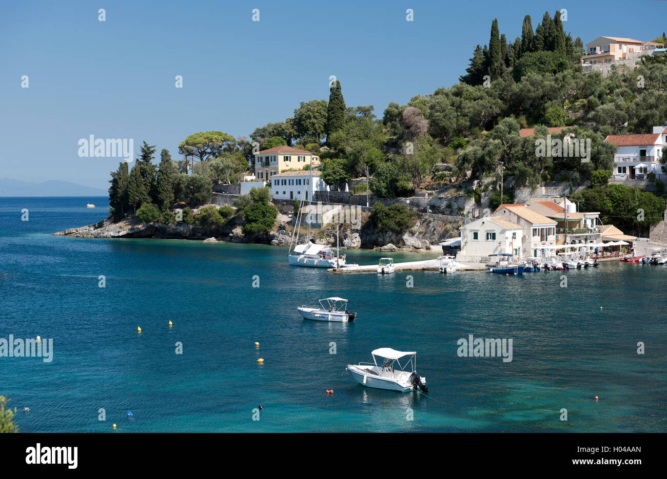 The picturesque harbour of Loggos on Paxos, The Ionian Islands, The Greek Islands, Greece, Europe - Stock Image