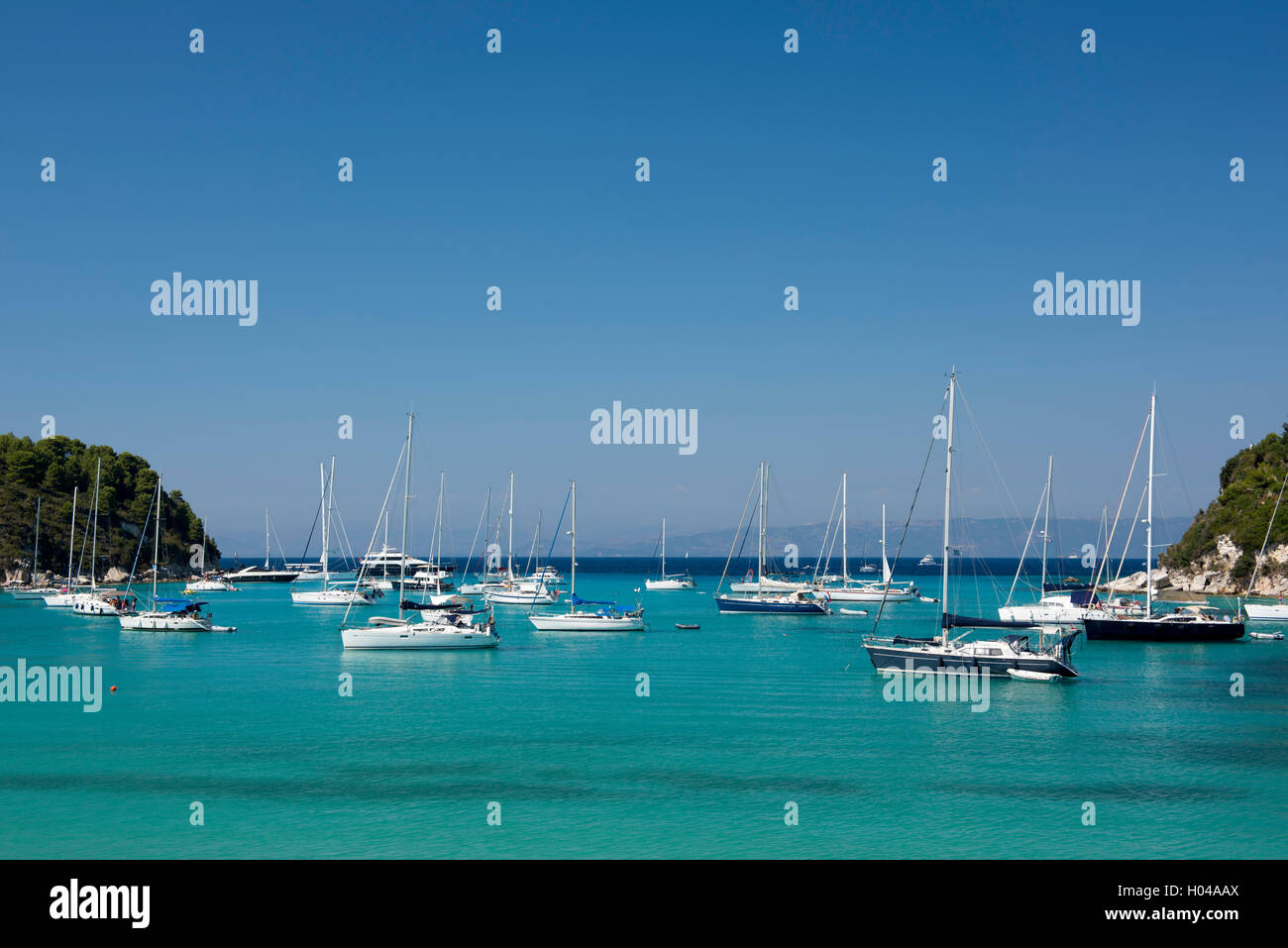Sailing yachts moored in Lakka harbour on the island of Paxos, The Ionian Islands, The Greek Islands, Greece, Europe - Stock Image