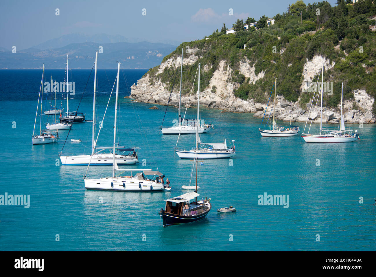 Sailing yachts in Lakka harbour on the island of Paxos, The Ionian Islands, The Greek Islands, Greece, Europe - Stock Image