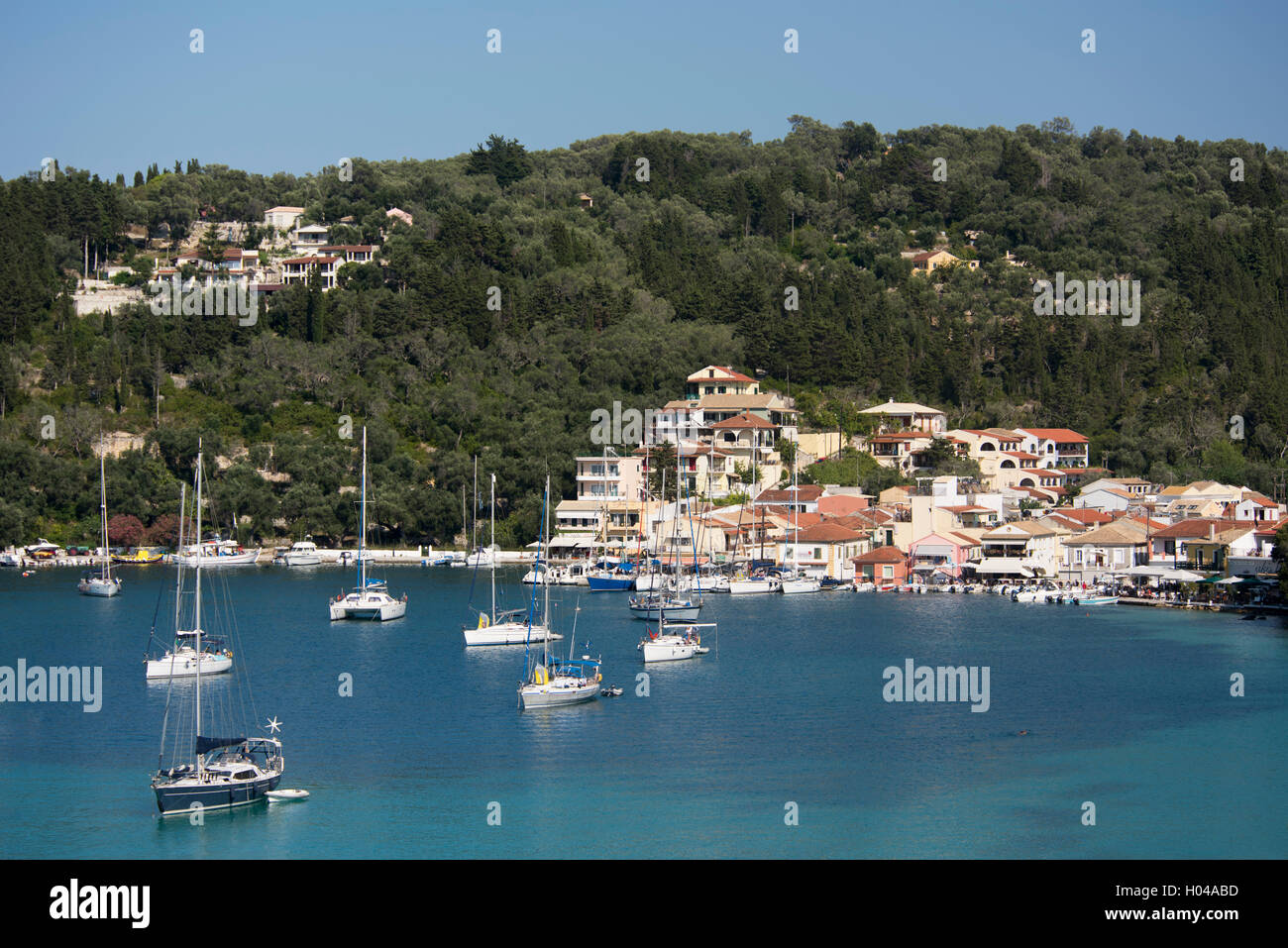 Sailing boats moored in Lakka harbour on Paxos, The Ionian Islands, The Greek Islands, Greece, Europe - Stock Image