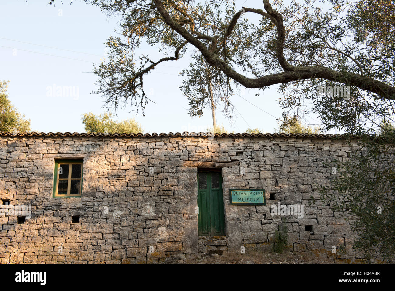 The Olive Press Museum on the island of Paxos, The Ionian Islands, The Greek Islands, Greece, Europe - Stock Image