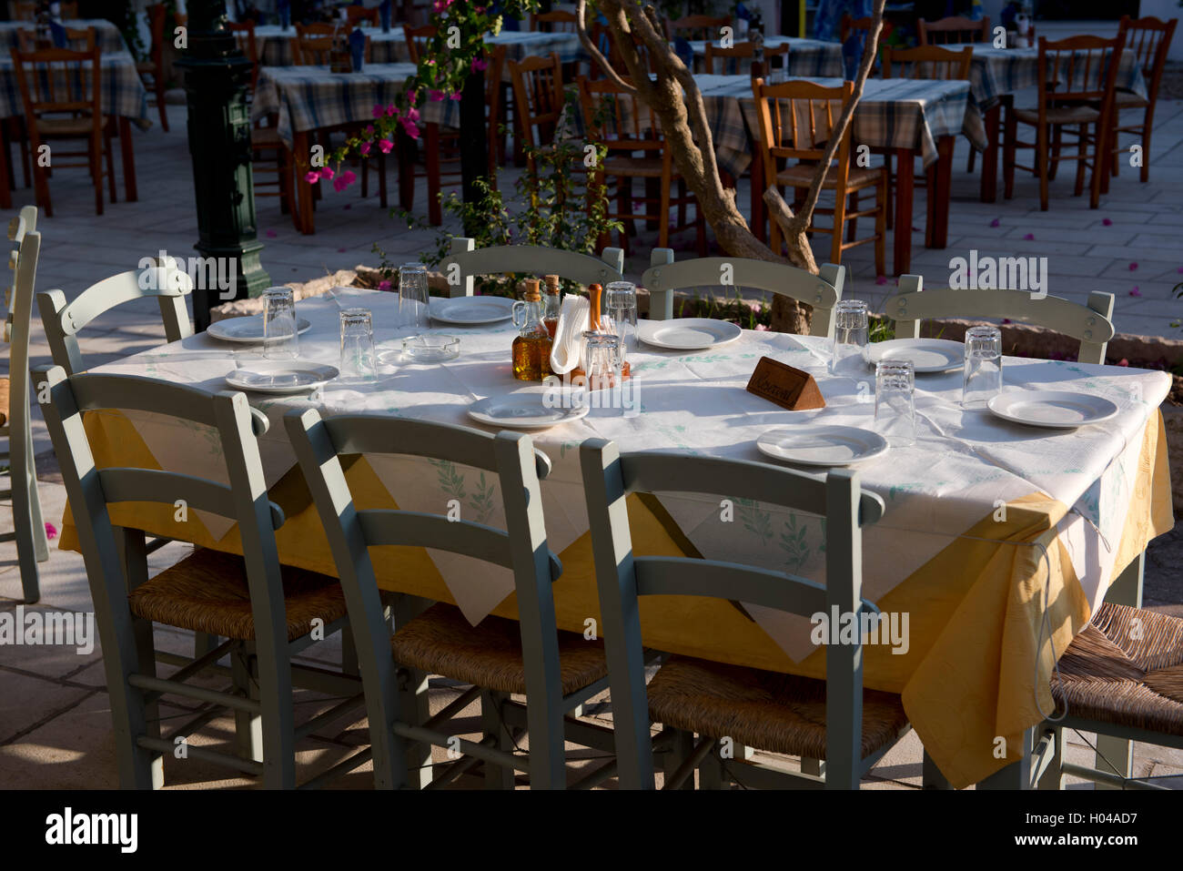 A taverna table in Lakka on Paxos, The Ionian Islands, The Greek Islands, Greece, Europe - Stock Image