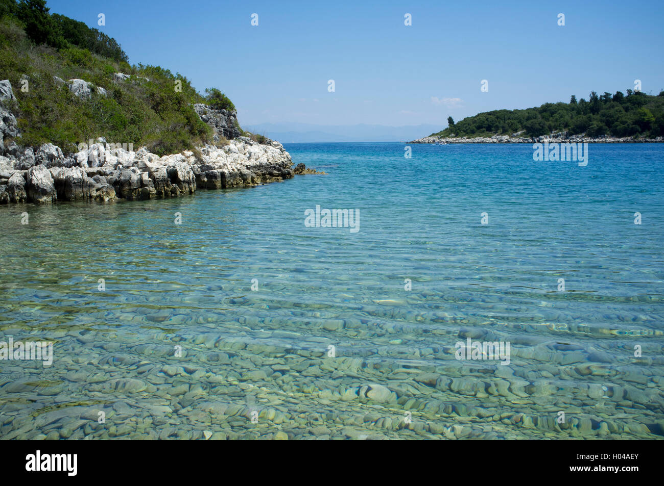An emerald cover at Lionarski on the southeast coast of Paxos,  The Ionian Islands, The Greek Islands, Greece, Europe - Stock Image