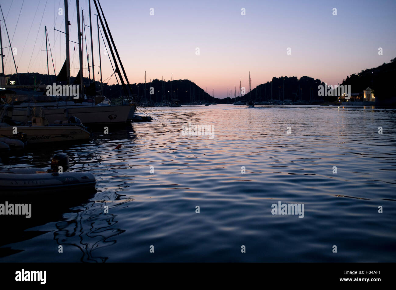 Sunset in Lakka harbour on the island of Paxos, The Ionian Islands, The Greek Islands, Greece, Europe - Stock Image