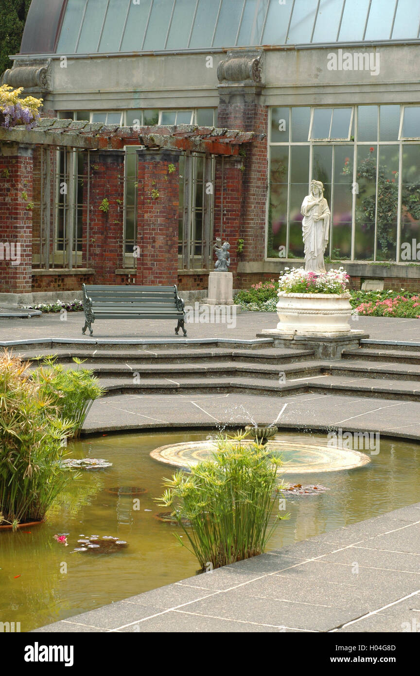 Square With Pond In Middle With Copies Of Classical Greek Statues  Surrounded By Vintage Greenhouse Buildings