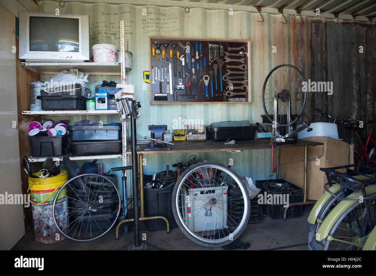 Workbench of a bicycle mechanic with tools arranged on a wall, Cape Town, South Africa - Stock Image