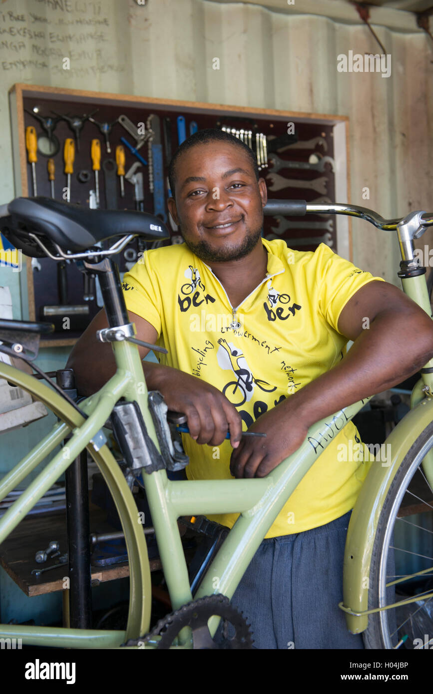 Bicycle mechanic servicing a bicycle in his workshop, Cape Town, South Africa Stock Photo