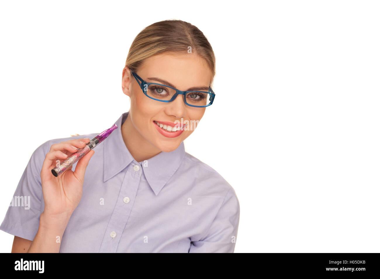 Young Woman Smokin Electic Cigarette Stock Photo