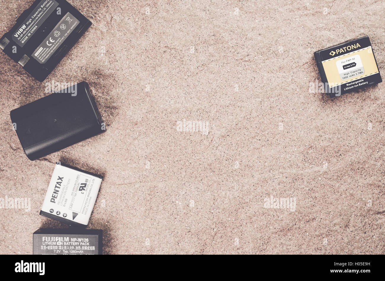 spare camera batteries on a stone worktop - copy space - Stock Image