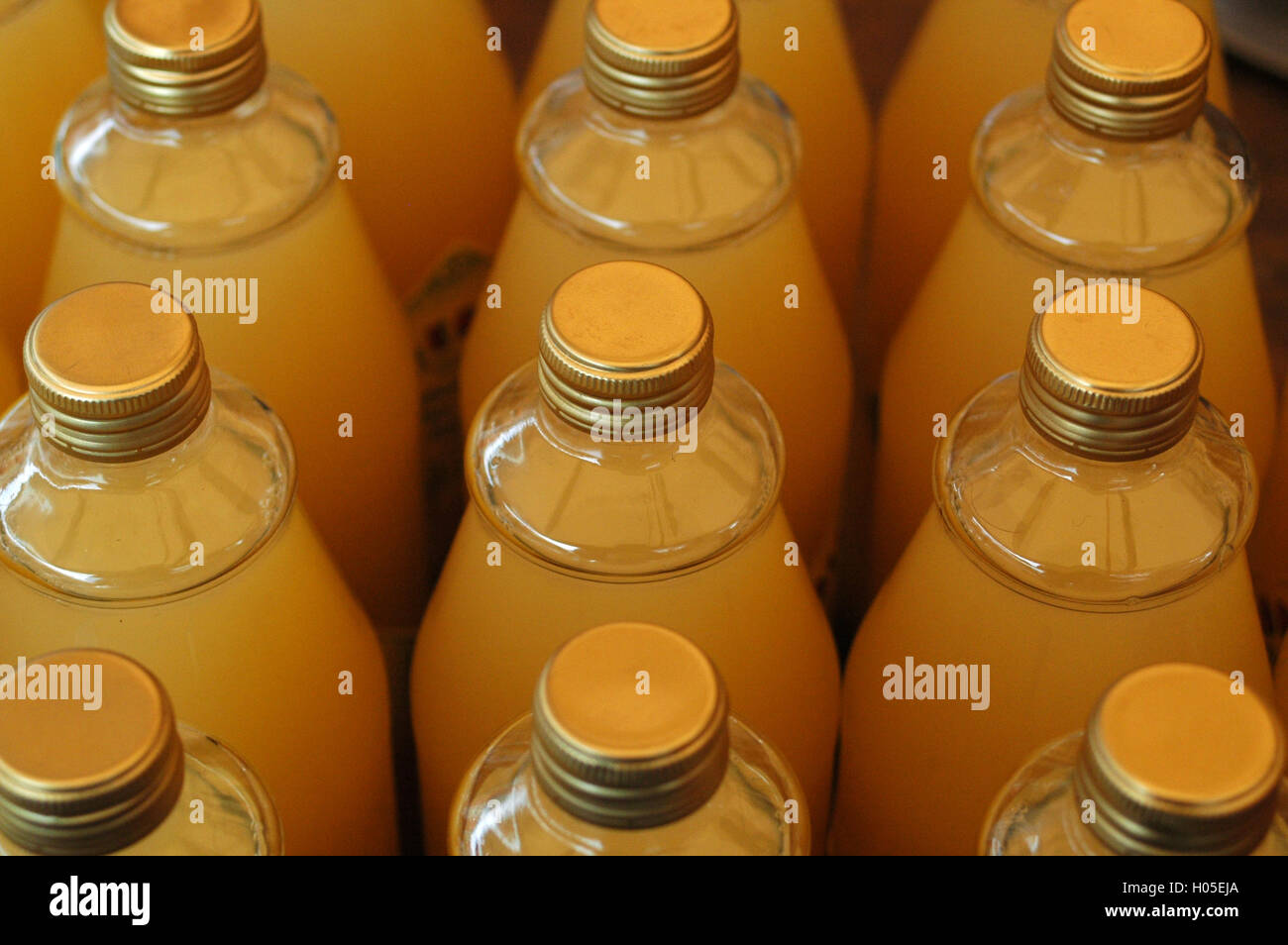Transparent glass bottles with metal screw - Stock Image