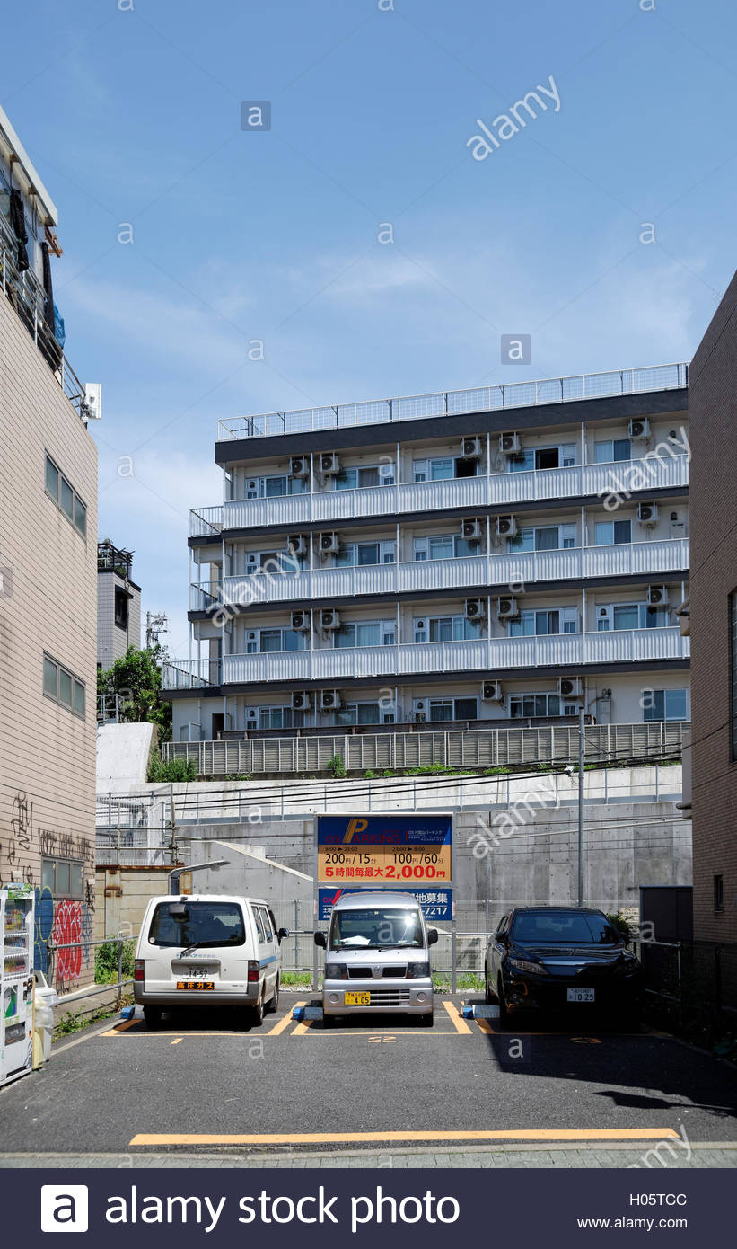 public parking lot in Ebisu, Tokyo and apartment buildings - Stock Image