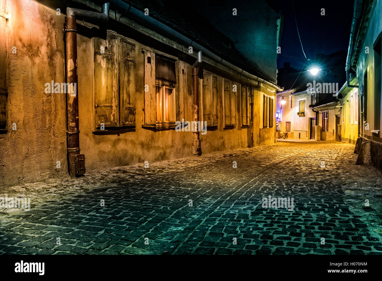 Dark deserted alley by night, in Sibiu, Romania (hollywood effect processing) - Stock Image