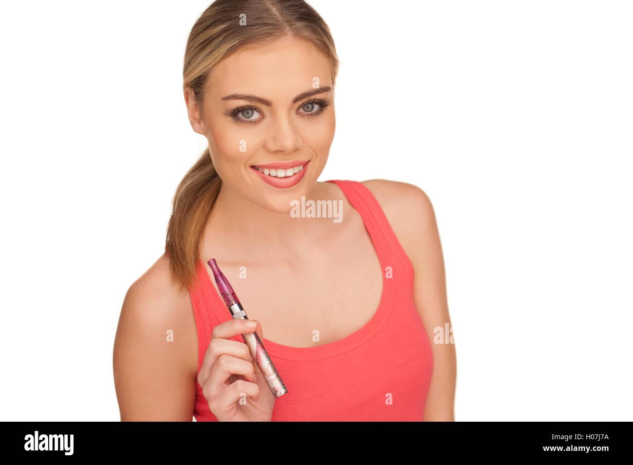 Young Woman Smokin Electic Cigarette - Stock Image