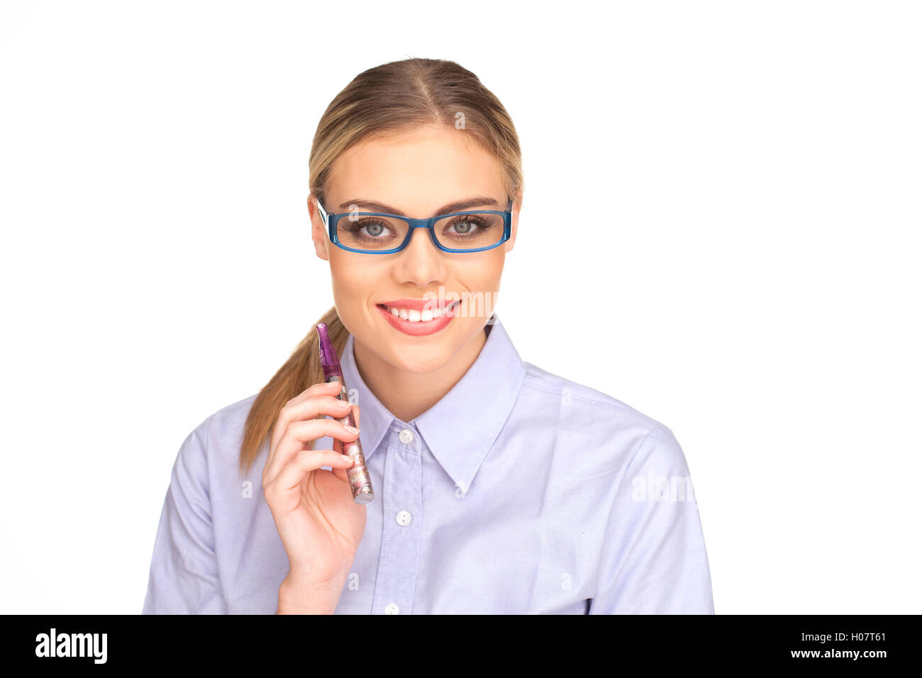 Young Woman Smokin Electic Cigarette - Stock Image