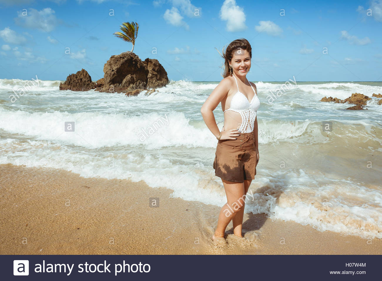 Woman in Tambaba Beach in Brazil, known for allowing the practice of