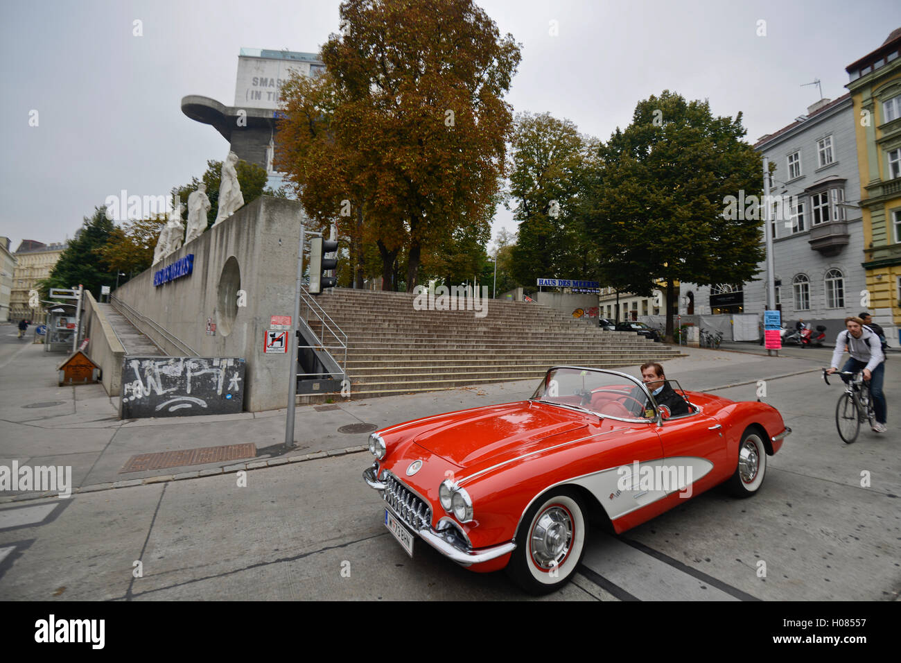 Aston Martin Red Convertible Driving In The Streets Of Vienna Stock