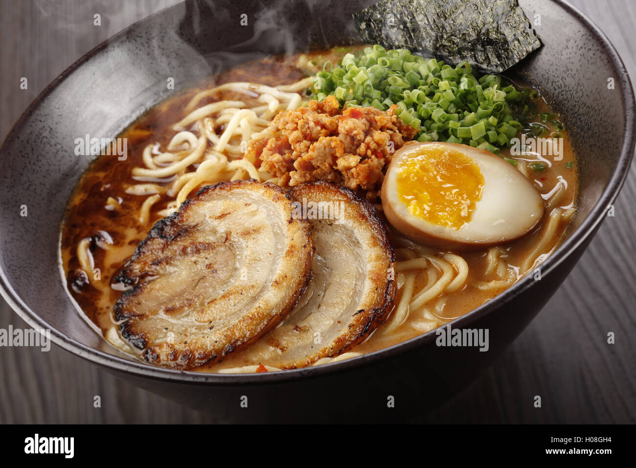 Classic Tantanmen, a rich miso-based broth infused with ground pork and egg - Stock Image