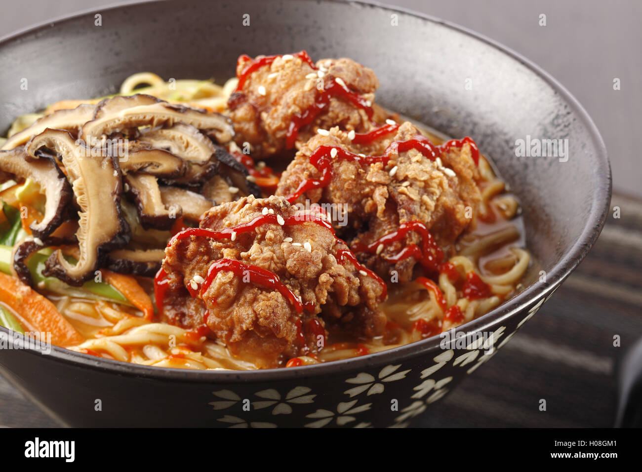 The chicken in Karaage Tantamen with deep-fried boneless chicken and shiitake mushrooms and a few other vegetables - Stock Image