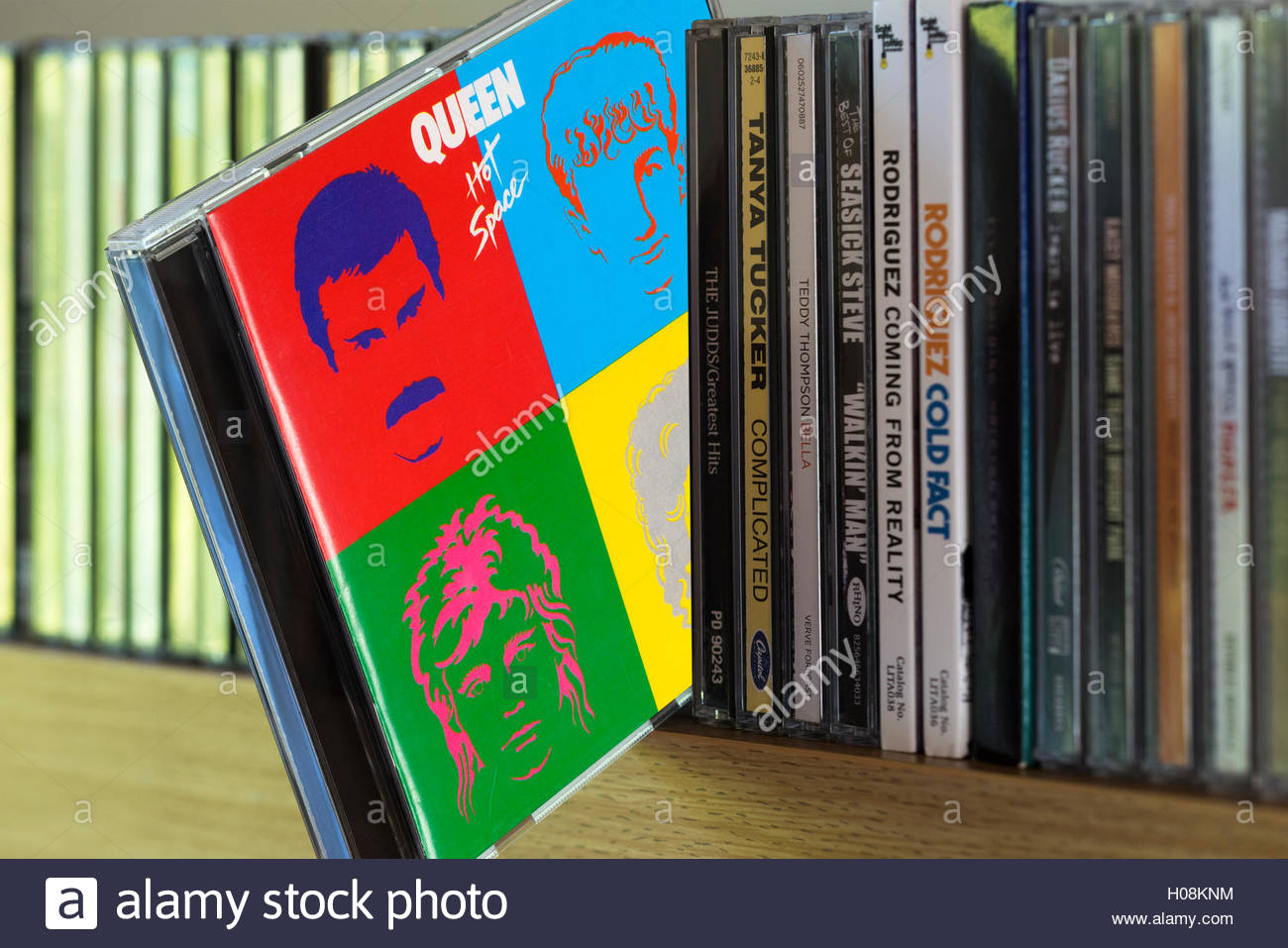 Queen album Hot Space CD pulled out from among other CD's on a shelf Stock Photo
