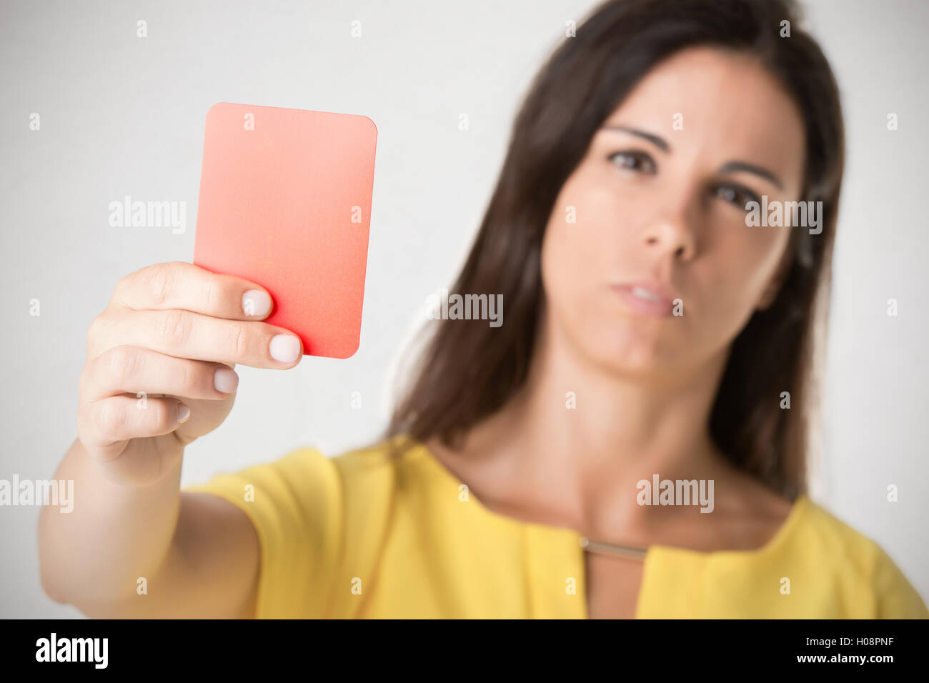 Woman showing a red card. Concept of relationship problems. - Stock Image