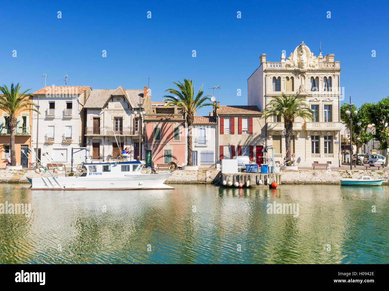 Buildings of different styles along the Canal du Rhône à Sète, Le Grau-du-Roi, Gard, France - Stock Image