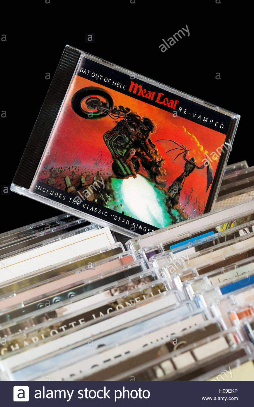 Meat Loaf Album Bat Out Of Hell CD pulled out from among rows of other CD's - Stock Image
