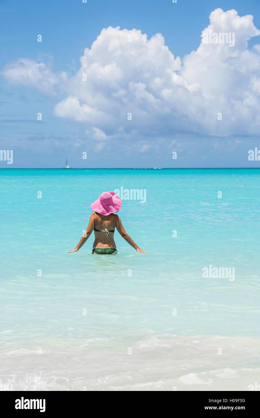 Bather in the turquoise waters of the Caribbean Sea, Jolly Beach, Antigua, Antigua and Barbuda, Leeward Islands, - Stock Image