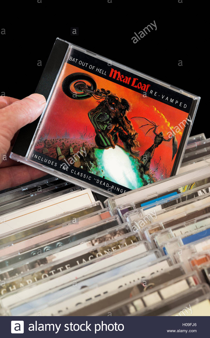 Meat Loaf Album Bat Out Of Hell CD CD being chosen from among rows of other CD's - Stock Image