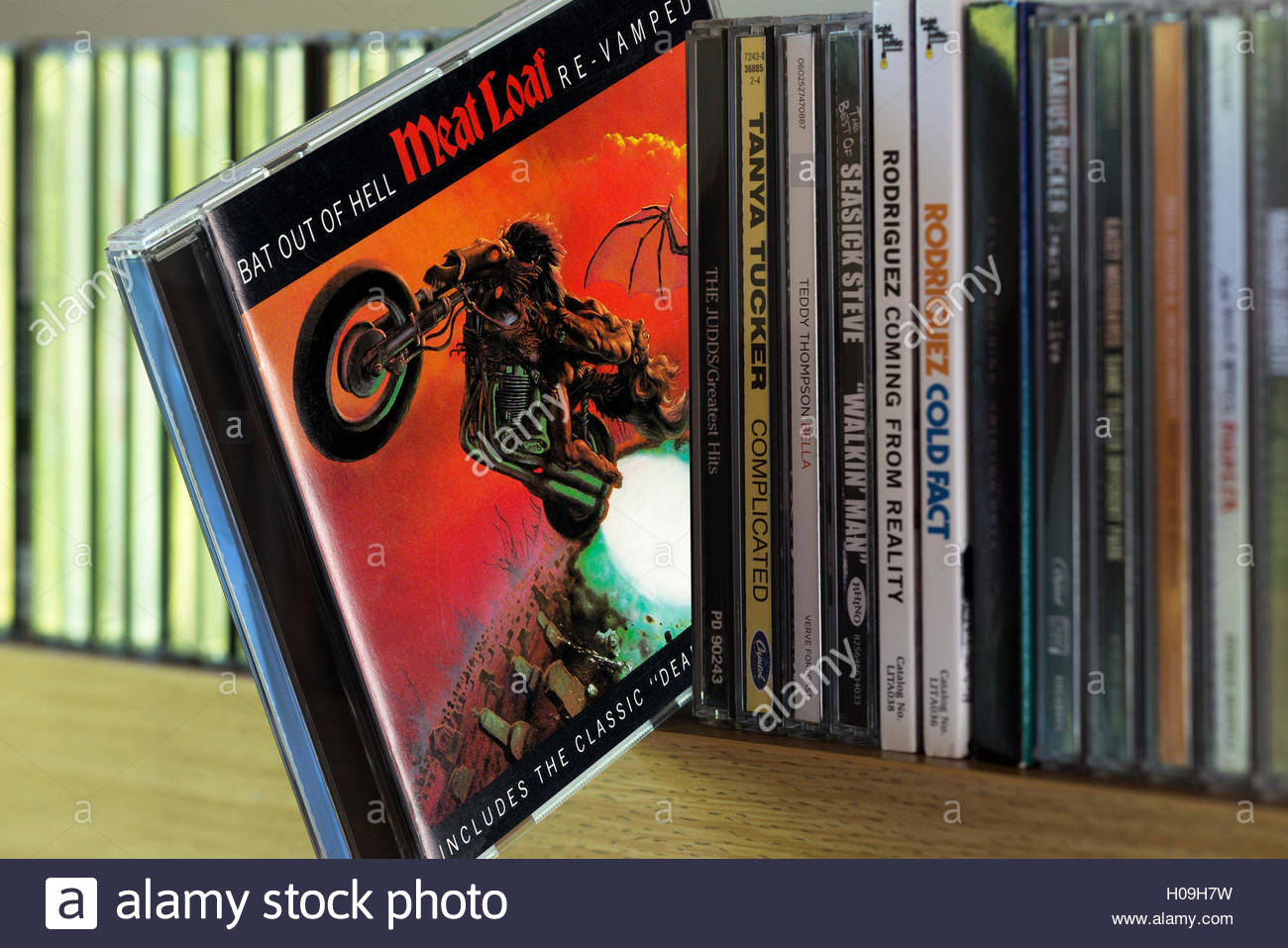 Meat Loaf Album Bat Out Of Hell CD pulled out from among other CD's on a shelf - Stock Image