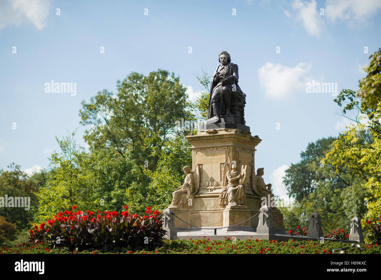 Bronze monument of the Dutch poet Vondel from 1867 is by Louis Royer, with the pedestal by Pierre Cuypers in Vondelpark, - Stock Image