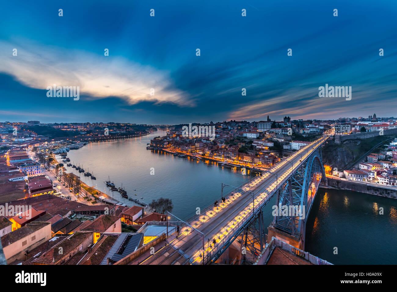 View over Porto with Ponte Dom Luís I Bridge across River Douro, dusk, Porto, Portugal - Stock Image