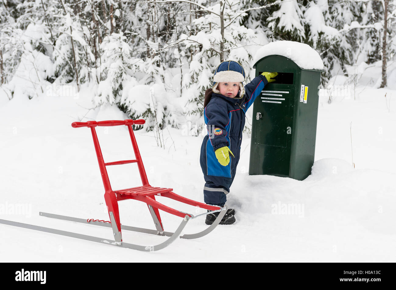 Young boy fetching the mail, Sweden - Stock Image