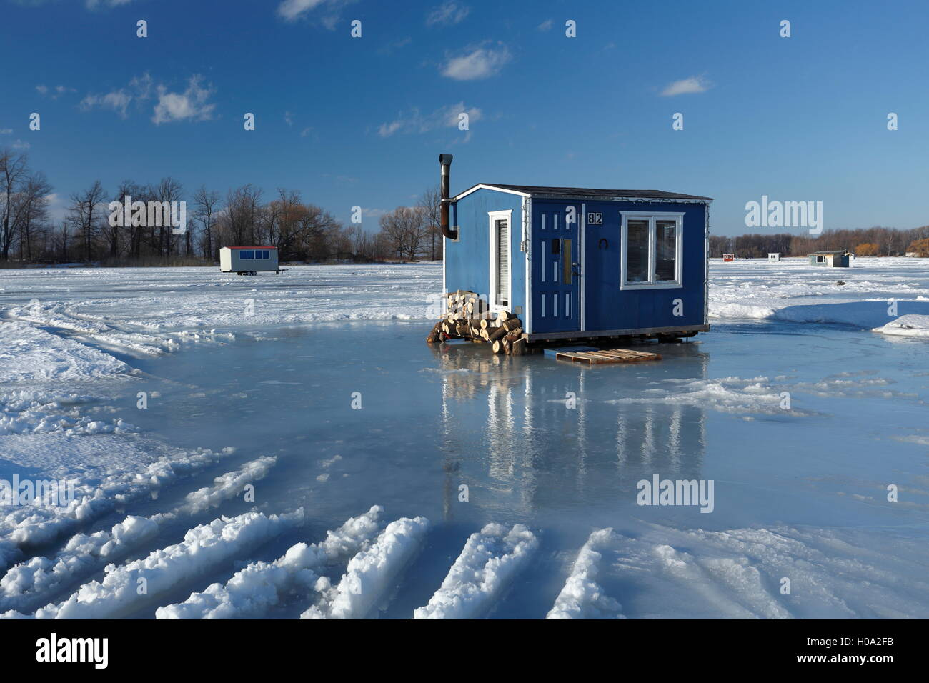 Canada log cabins snow stock photos canada log cabins for Ice fishing cabins alberta