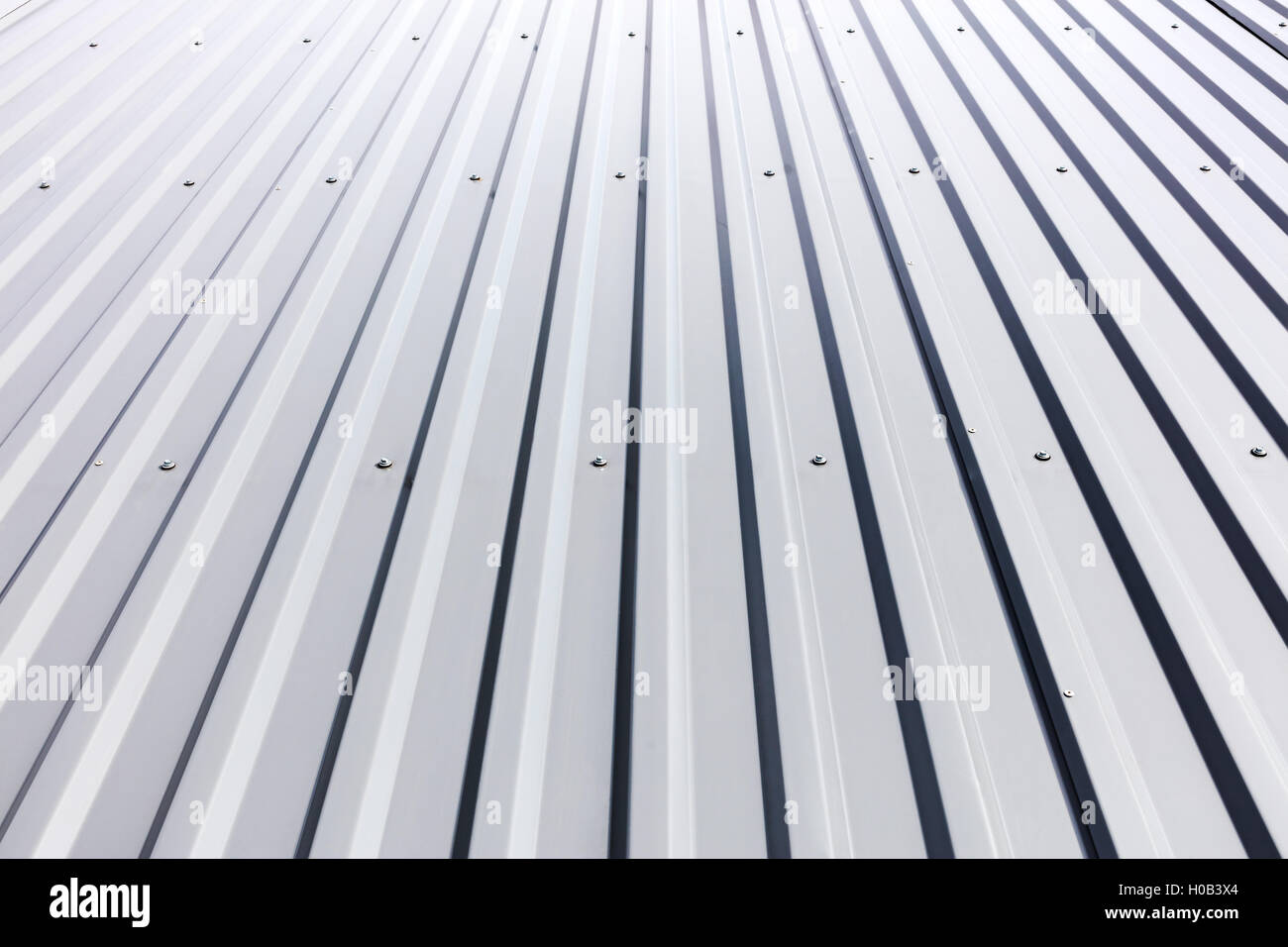 corrugated steel cladding with rivets on roof of industrial