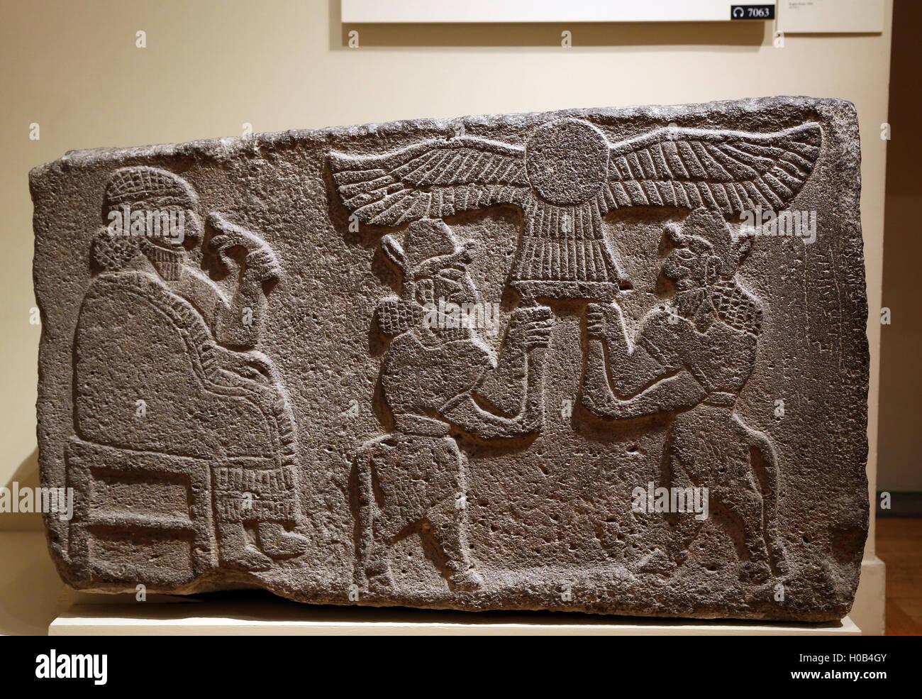 North Syrian. Orthostats relief. Seated figure holding lotus flower. Limestone. Tell Halaf.  Neo-Hittite.9th c. Stock Photo