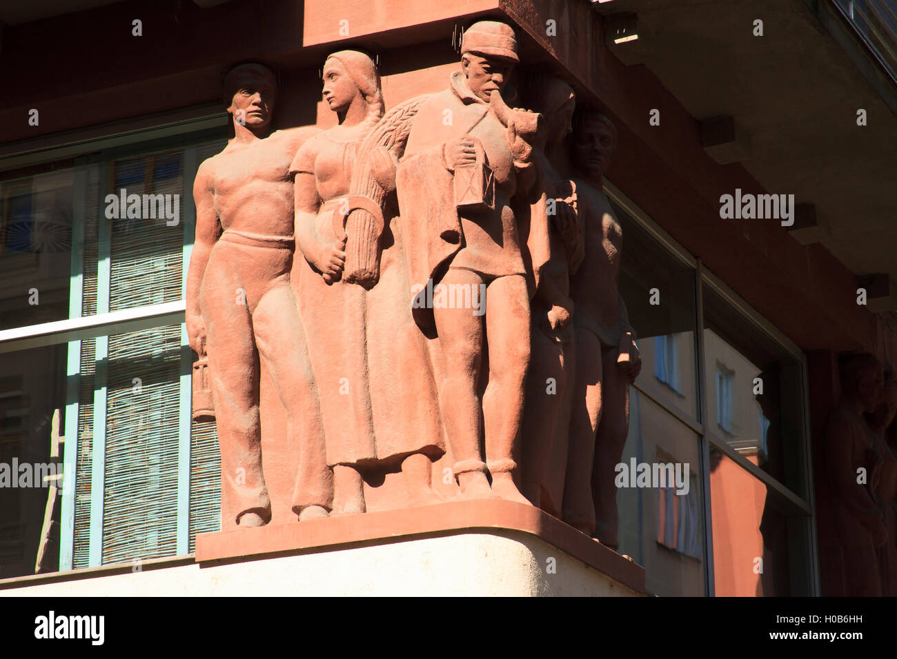 Decorative sculpture of socialist realism style of architecture. Detail of building facade in Ostrava, Czech Republic. - Stock Image