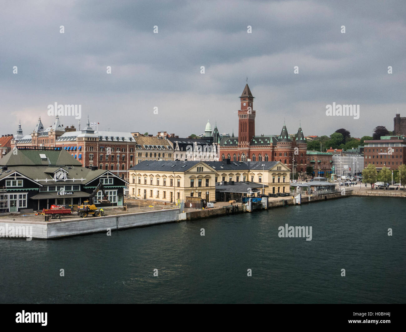 The port and down-town of Helsingborg in south Sweden as seen from the ferry from Elsinore in Denmark - Stock Image