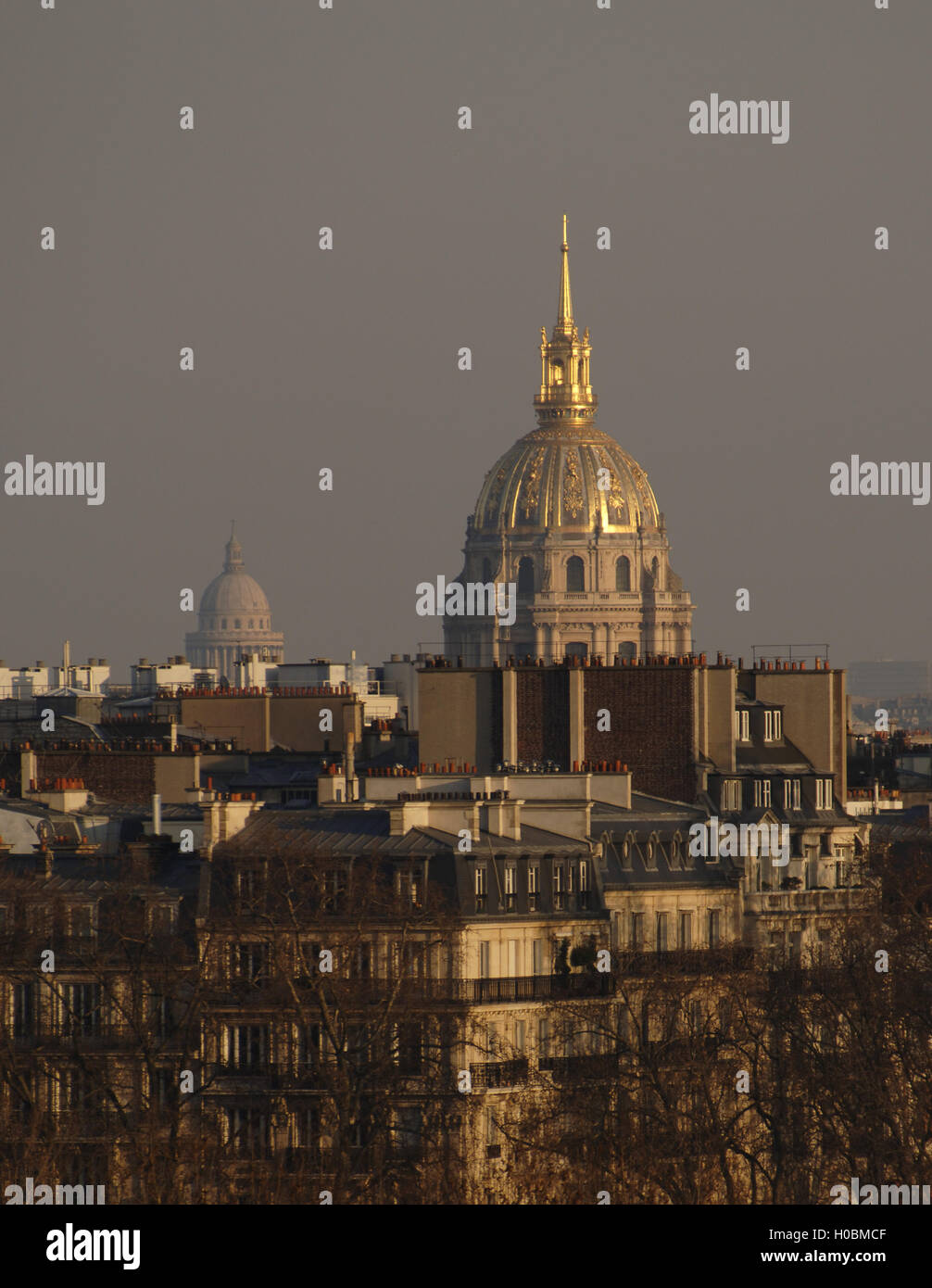 France. Paris. Cityscape. In the background stands the golden dome of the Saint Louis des Invalides Cathedral, built - Stock Image