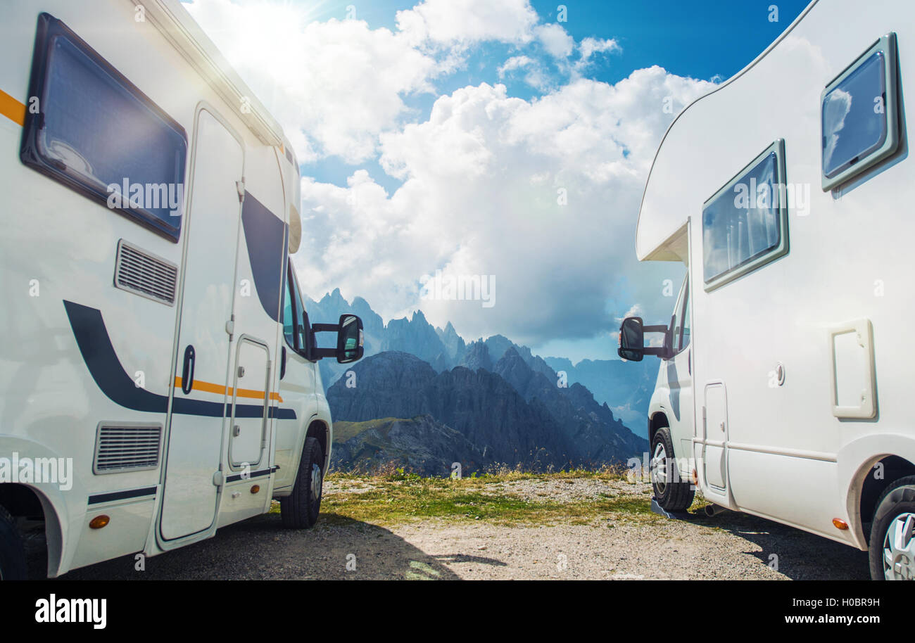 High Mountain Campers Camping. Two Motorhomes and the Scenic Mountain View. Outdoor and RVing Theme. - Stock Image