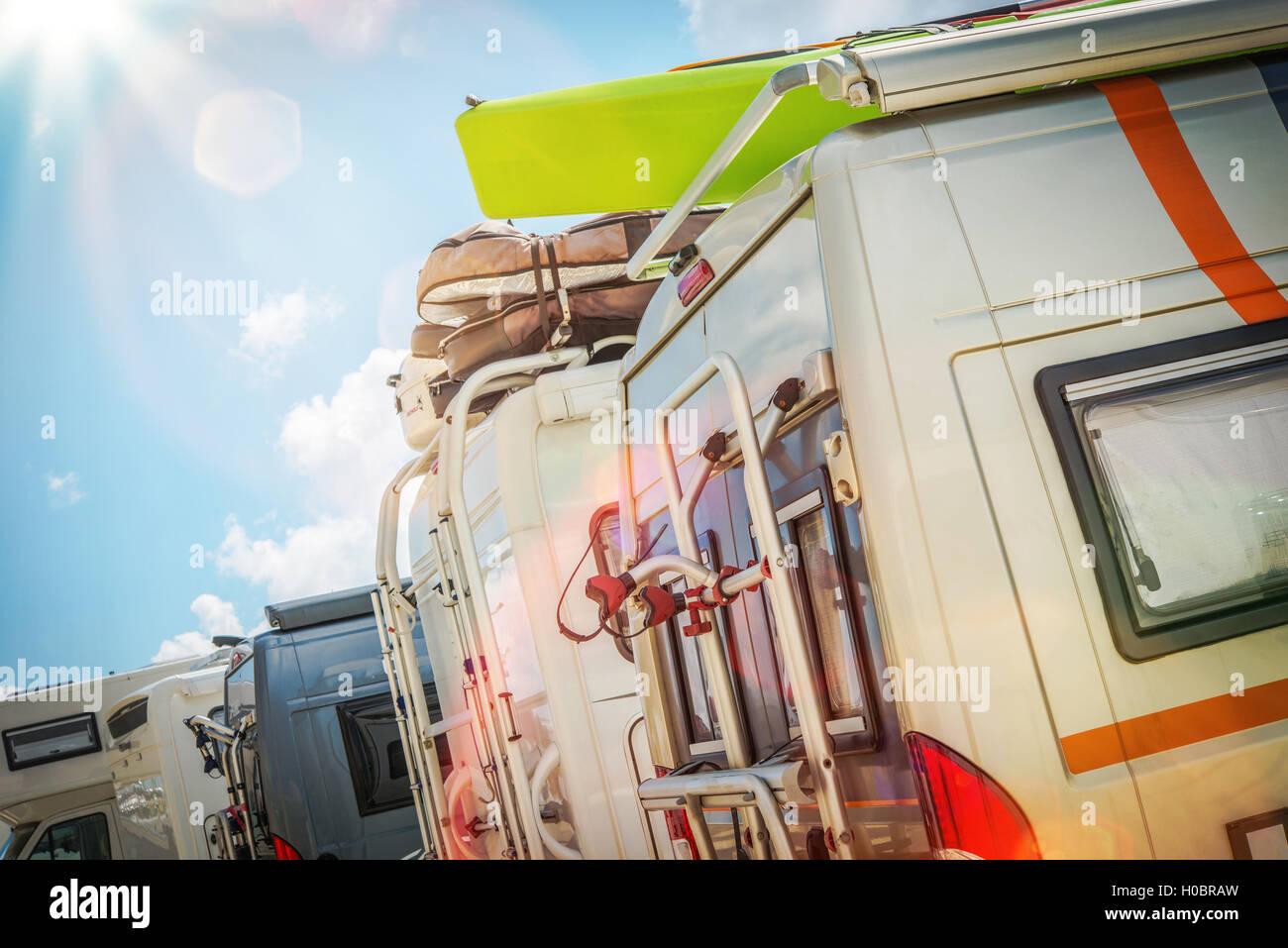 Motorhomes RV Park. Class B Motorcoaches Parking Closeup. - Stock Image