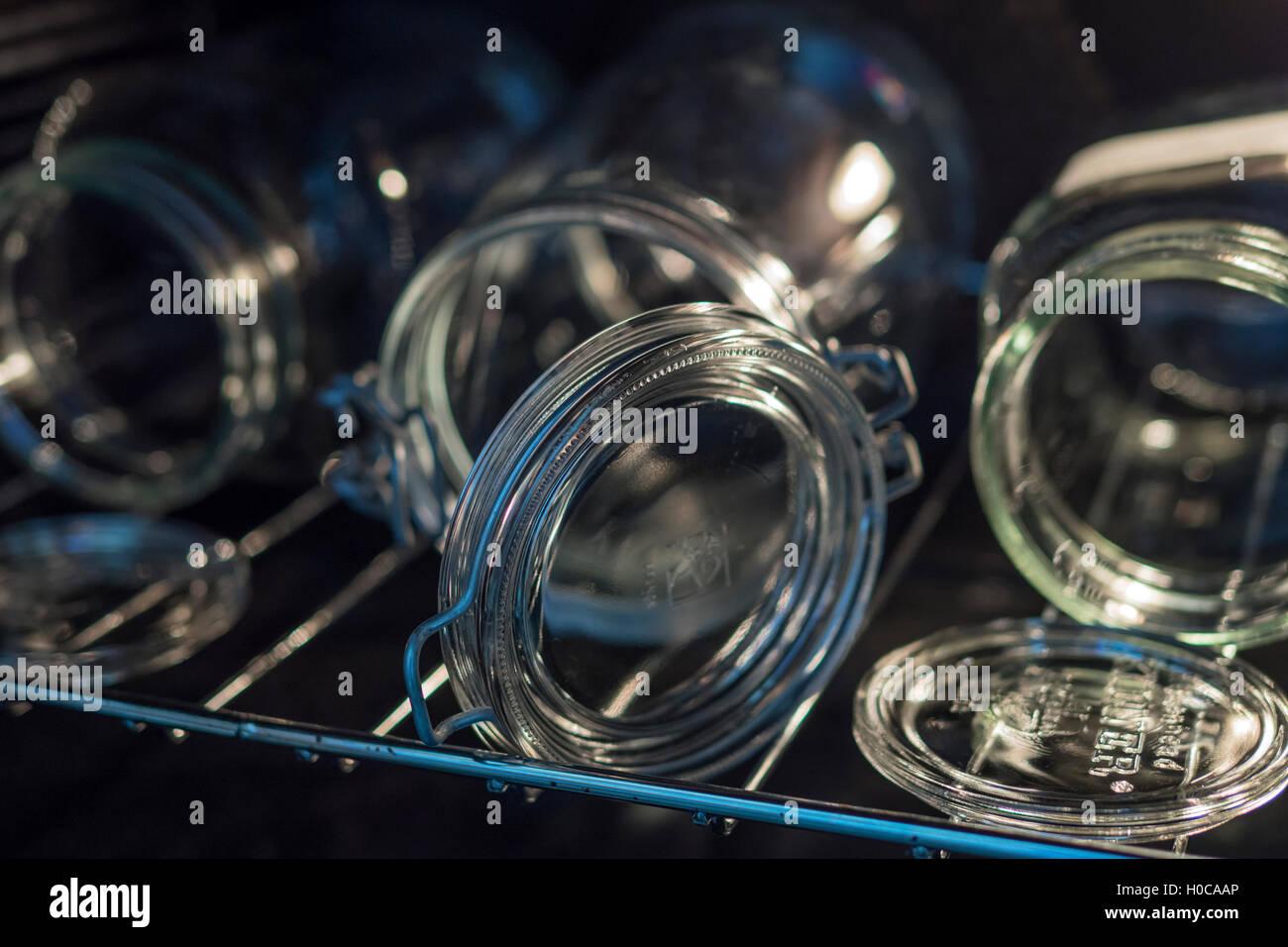 Sterilising kilner jars in the oven - Stock Image