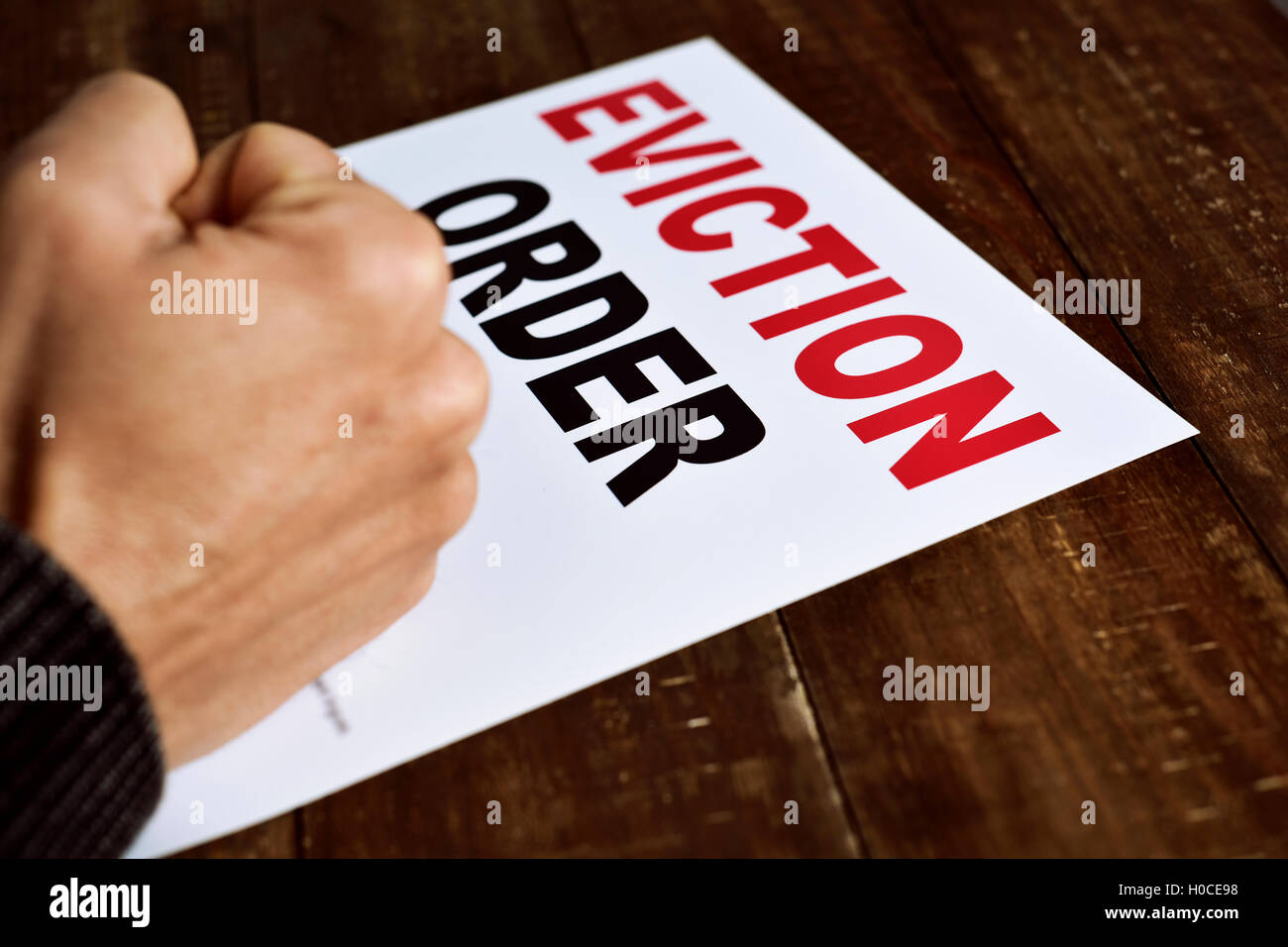 closeup of a young caucasian man concerned because has just received an eviction order - Stock Image