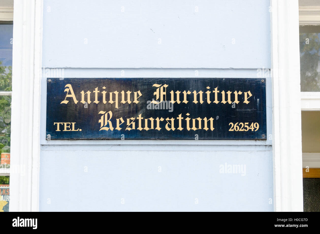 Antique Furniture Restoration sign outside a shop in Cheltenham - Stock Image
