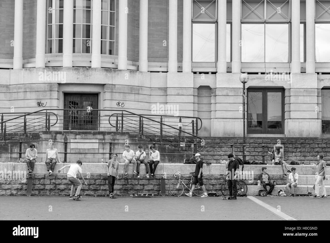 Monochrome, youths skateboarding in Bristol City Harbour, Bristol, England, UK - Stock Image